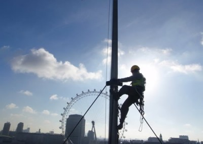 Rope Access Technician Working on a Flagpole high over London